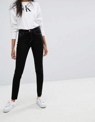 Calvin Klein Jeans High Rise Skinny Jean with Raw Hem and Contrast Stitch