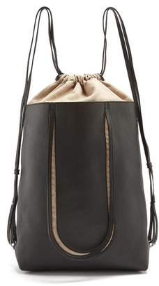Maison Margiela Contrast-panel drawstring leather backpack