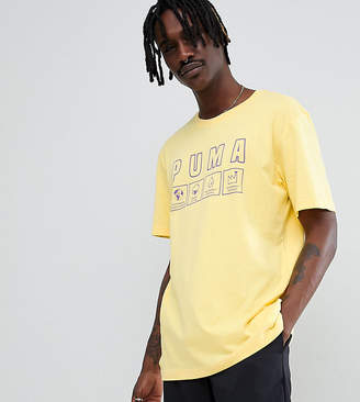 Puma organic cotton t-shirt with print in yellow Exclusive at ASOS