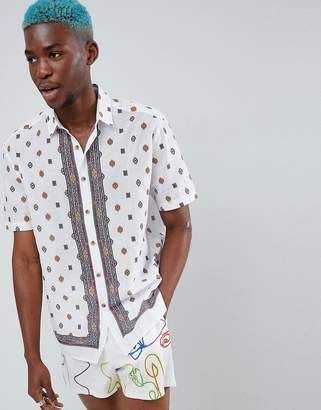 Asos DESIGN oversized shirt with geo-tribal placement print in white