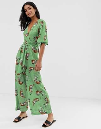 Liquorish wide leg jumpsuit in green with tiger print