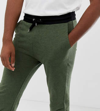 Asos DESIGN tall skinny joggers in khaki interest fabric with contrast waistband and cuffs