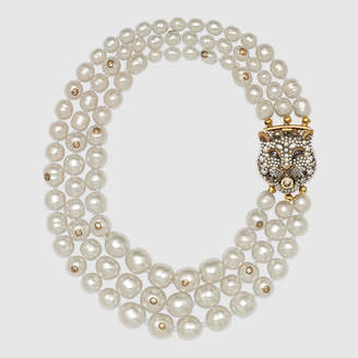 Gucci Layered pearl necklace with feline closure