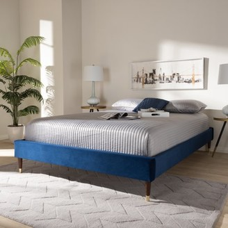 Baxton Studio Volden Glam and Luxe Navy Blue Velvet Fabric Upholstered Queen Size Wood Platform Bed Frame with Gold-Tone Leg Tips