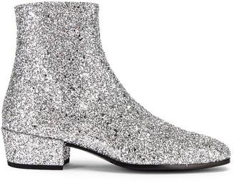 Saint Laurent Caleb Glitter Zip Boots in Silver | FWRD