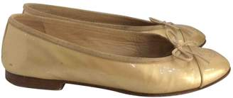 Chanel Gold Patent leather Ballet flats