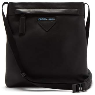Prada Logo Embossed Leather Messenger Bag - Mens - Black