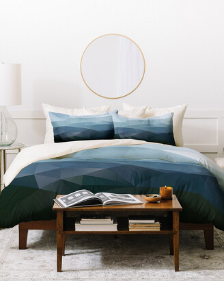 Deny Designs Three Of The Possessed First Light Duvet Cover Set