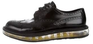 Prada Round-Toe Wingtip Derby Shoes