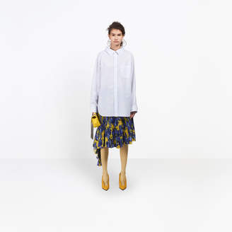 Balenciaga Swing striped shirt, delicately uncovers the neckline