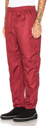 Givenchy Snap Jogger in Red | FWRD