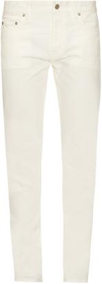 SAINT LAURENT Five-pocket slim-leg jeans $433 thestylecure.com