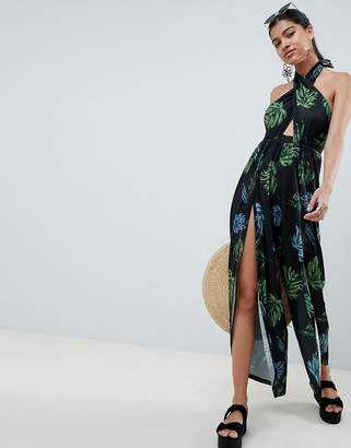 Asos DESIGN cross front jumpsuit with wrap leg detail in dark leaf print