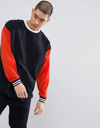 Asos DESIGN oversized sweatshirt with woven and mesh panels