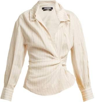 Jacquemus Striped twist-front linen and cotton-blend shirt