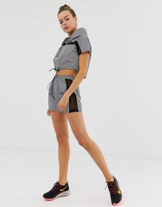 Missguided gym reflective sports shorts with mesh panels in grey