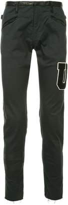 Undercover letter patch skinny trousers