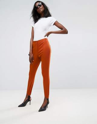 Asos DESIGN Washed Skinny Pants with Stirrup Detail