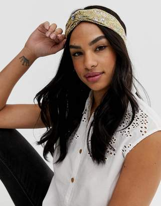 Asos Design DESIGN headband with twist front in pretty ditsy floral print