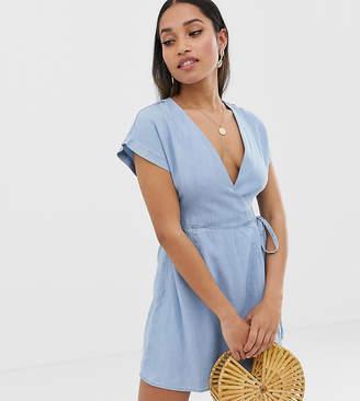 Asos DESIGN Petite denim wrap dress in lightwash blue