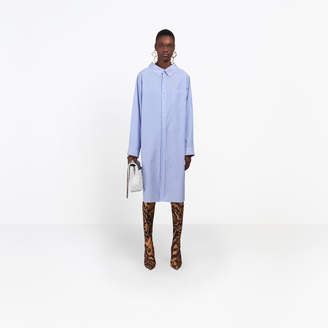 Balenciaga Swing striped shirt-dress, delicately uncovers the neckline