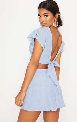 PrettyLittleThing Blue Plunge Frill Sleeve Crop Blouse