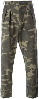 Faith Connexion camouflage print trousers