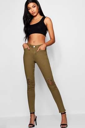 boohoo Mid Rise Distressed Knee Skinny Jeans
