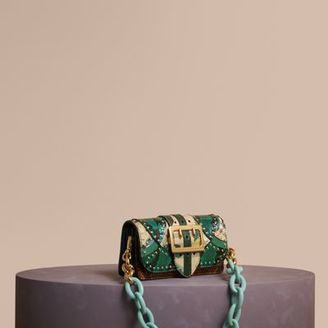 Burberry The Small Buckle Bag in Riveted Snakeskin and Floral Print $2,495 thestylecure.com