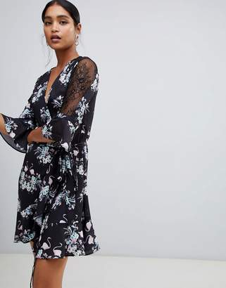 Liquorish bird and floral print wrap mini dress with mesh sleeves