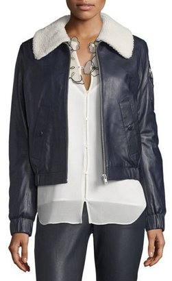 See by Chloe Leather Bomber Zip-Front Jacket, Navy $845 thestylecure.com