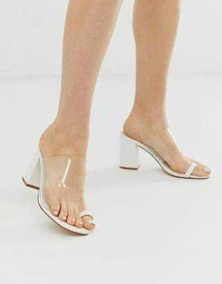 Truffle Collection clear strap heeled mules with toe loop