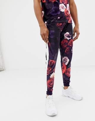 Asos Design DESIGN two-piece skinny velour sweatpants in floral print with side stripe