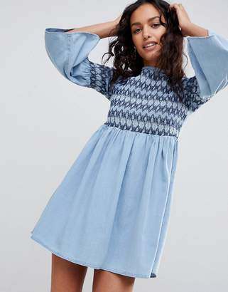 Asos DESIGN denim smock dress with embroidery in midwash blue