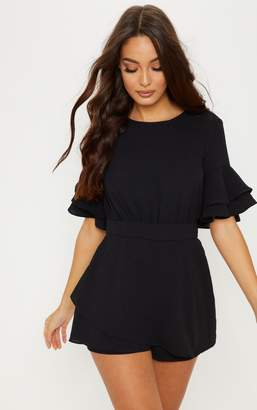 PrettyLittleThing Black Frill Sleeve Tie Back Playsuit