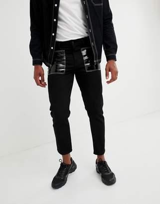 Asos DESIGN slim jeans in black with vinyl pockets