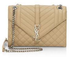Saint Laurent Medium Monogram Tri-Quilted Leather Shoulder Bag $2,190 thestylecure.com