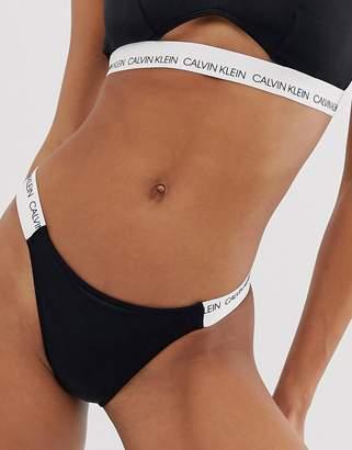 8c2ab789fc2f7 Calvin Klein cheeky logo strap bikini bottom in black