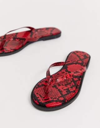 8fe723ee5 Asos Design DESIGN Fantom flip flops in red snake print
