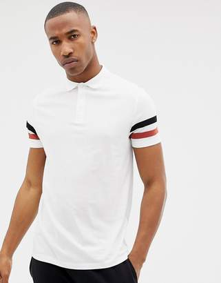 Asos Design DESIGN polo shirt with contrast sleeve stripe in white