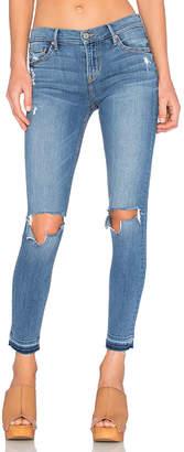 GRLFRND Candice Mid-Rise Super Stretch Skinny Jean.
