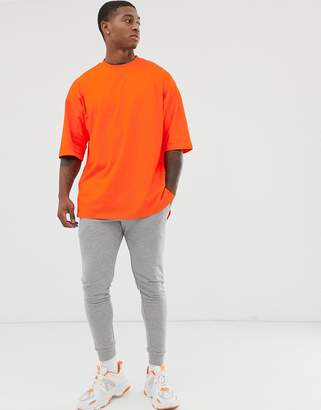 Asos Design DESIGN oversized t-shirt with side split in orange