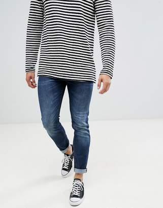 Benetton slim fit jeans in dark wash blue