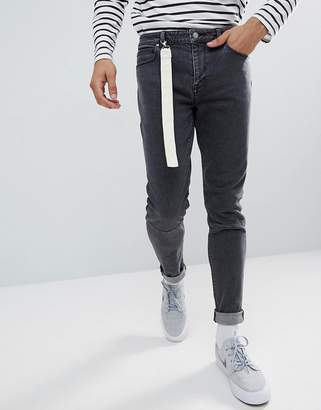 Asos DESIGN Skinny Jeans In Washed Black With Strap Detail