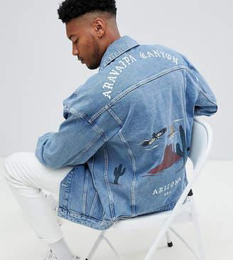 Asos DESIGN Tall oversized denim jacket with back print