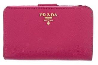 Prada Saffiano Compact Wallet $195 thestylecure.com