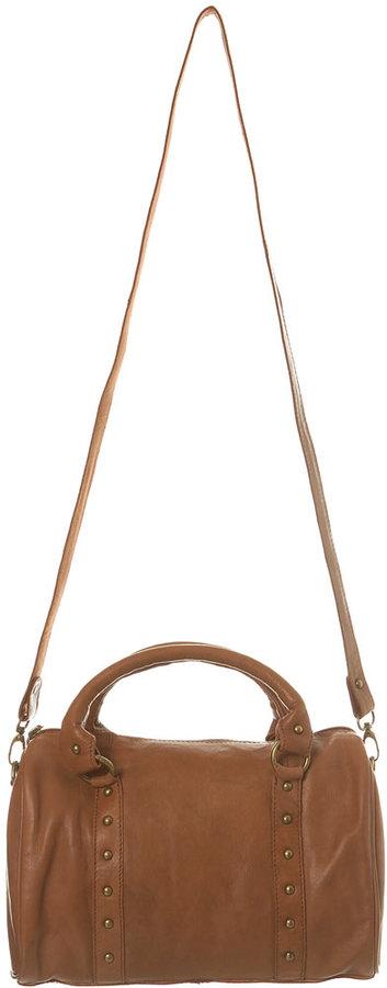 Tan leather studded barrel bag