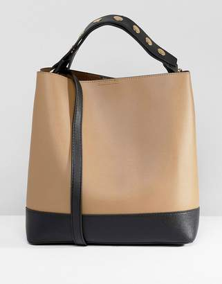 Warehouse bucket bag with popper strap in tan