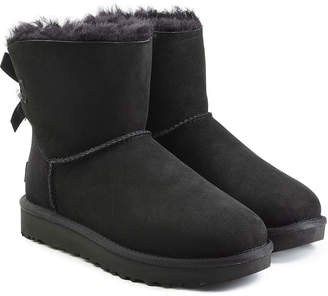 at STYLEBOP.com · UGG Mini Bailey Bow Shearling Lined Suede Boots