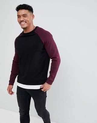 Asos DESIGN Sweatshirt In Black With Burgundy Raglan Sleeves